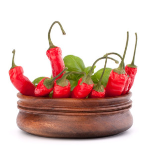 Hot red chili or chilli pepper in wooden bowl